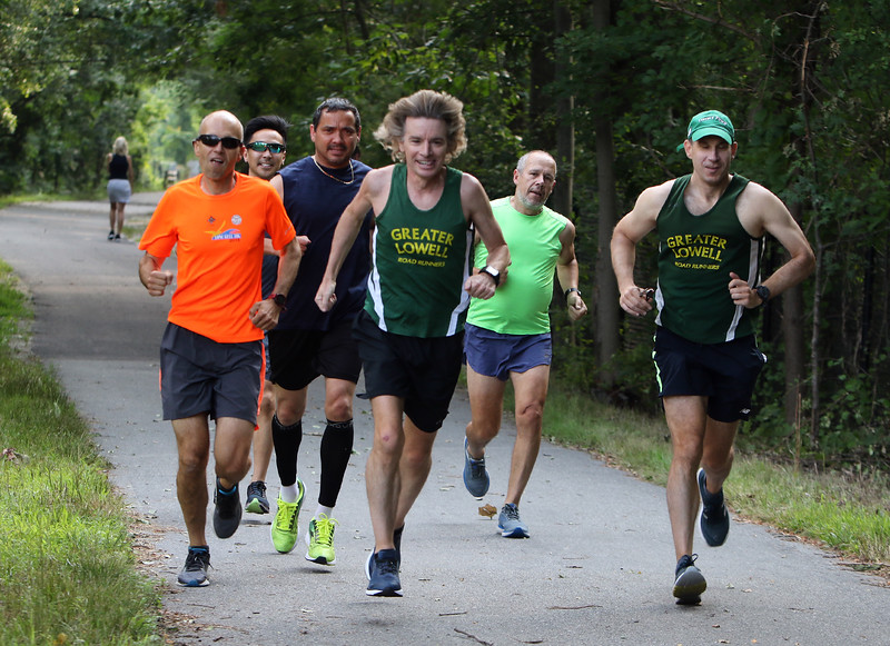 July 21, 2021 -- Regular runner Jim Rhoades of Lowell, with running friends, on the start of the Bruce Freeman Trail at Cross Point.  From left, Colin Loghin of Westford, Tony Ly of Lowell, Luis Rios of Lowell, Jim Rhoades, Jim Quadros of Lowell, and Frank Georges of Lowell.  SUN/Julia Malakie