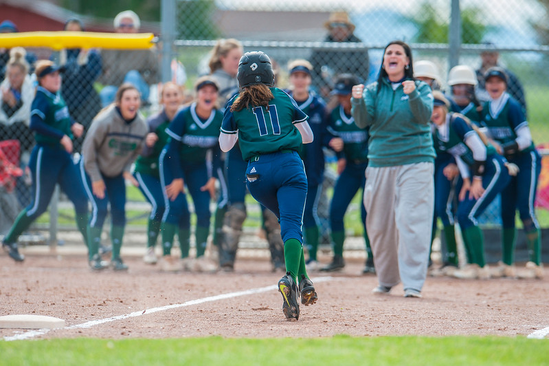 Copper Hills base runner Gomez (11) changes the momentum of the game with a home run against Fremont High School. Her team cheers her on as she runs to home plate Thursday in Plain City On May 18, 2017.