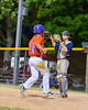 Cortland Crush Patrick Messinger (14) scores a run against the Syracuse Salt Cats on Greg's Field at Beaudry Park in Cortland, New York on Wednesday, June 29, 2016. Cortland won 5-4 in 13 innings.