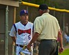 Cortland Crush Manager Bill McConnell talks with the Umpire during a game with the Syracuse Junior Chiefs on Greg's Field at Beaudry Park in Cortland, New York on Friday June 5, 2015. Cortland won 5-2.