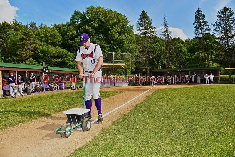 Cortland Crush Joseph Jones (17) chalking the first base line before playing the Syracuse Junior Chiefs on Greg's Field at Beaudry Park in Cortland, New York on Friday June 5, 2015.