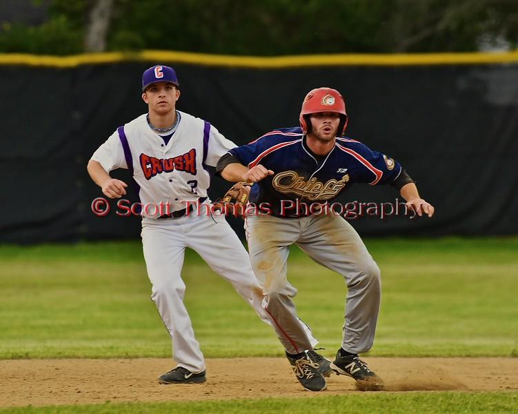 Cortland Crush Hank Pellicciotti (2) shadowing a Syracuse Junior Chiefs base runner on Greg's Field at Beaudry Park in Cortland, New York on Friday June 5, 2015. Cortland won 5-2.