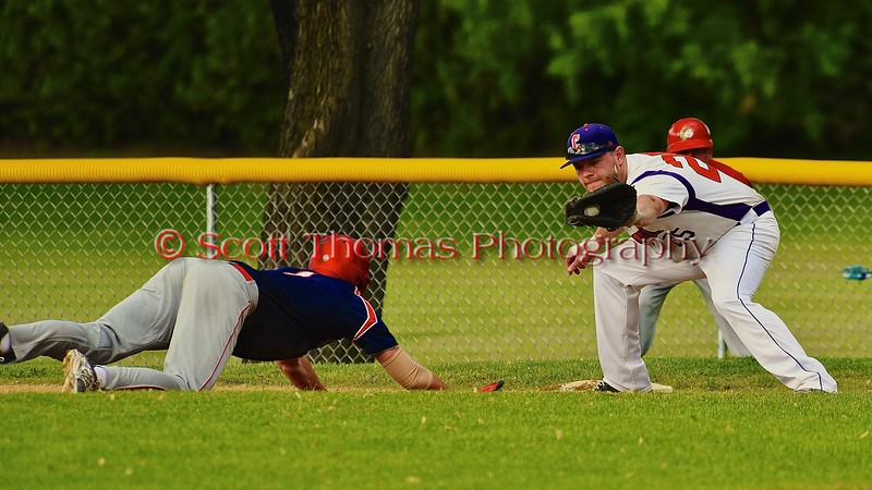 Cortland Crush Zephan Kash (25) looking to make a tag against a Syracuse Junior Chiefs base runner on Greg's Field at Beaudry Park in Cortland, New York on Friday June 5, 2015. Cortland won 5-2.