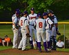 Cortland Crush players and manager meeting at the mound during a time out against the Syracuse Junior Chiefs on Greg's Field at Beaudry Park in Cortland, New York on Friday June 5, 2015. Cortland won 5-2.