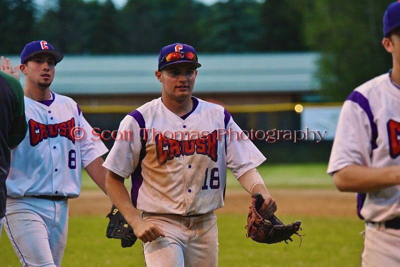 Cortland Crush Grant Hoover (18) celebrating a win over the Syracuse Junior Chiefs on Greg's Field at Beaudry Park in Cortland, New York on Friday June 5, 2015. Cortland won 5-2.