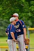 Syracuse Junior Chiefs Jose Arebalo (7) talks with Junior Chiefs pitcher Jean-Carlos Berasgoico (26) in a game against the Cortland Crush on Greg's Field at Beaudry Park in Cortland, New York on Friday June 5, 2015. Cortland won 5-2.