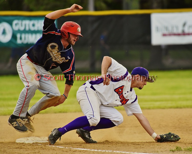 Cortland Crush Wesley Burghardt (8) and Syracuse Junior Chiefs James Wynne (11) at third base on Greg's Field at Beaudry Park in Cortland, New York on Friday June 5, 2015. Cortland won 5-2.