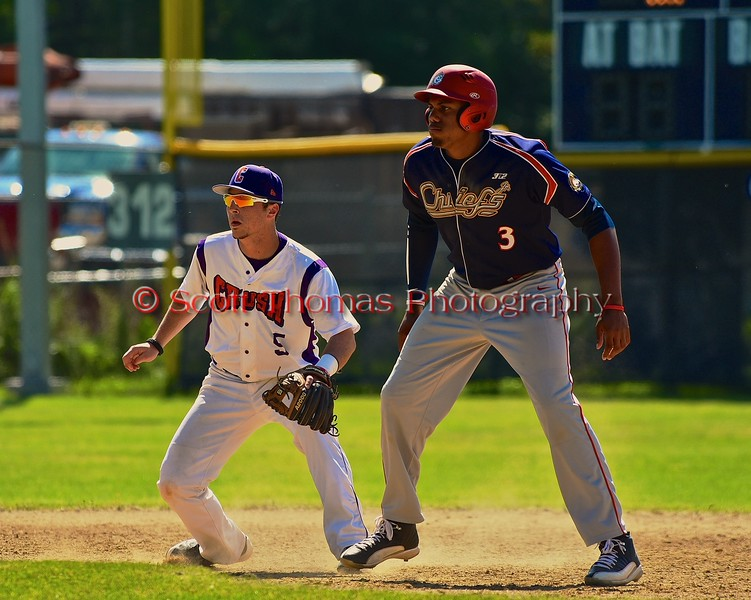 Cortland Crush Matthew Alberino (5) shadowing Syracuse Junior Chiefs base runner Malik Fogg (3) on Greg's Field at Beaudry Park in Cortland, New York on Sunday June 7, 2015. Syracuse won 11-8.