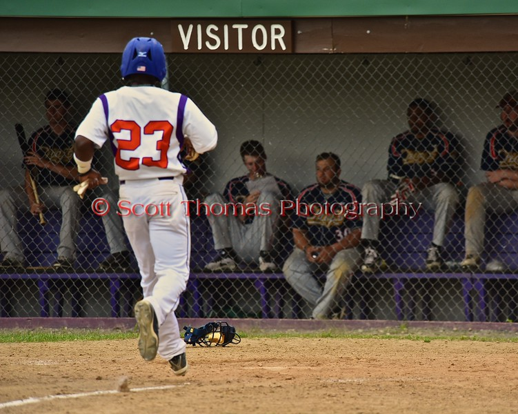 Cortland Crush Terrell Barringer (23) scores a run against the Syracuse Junior Chiefs who were not amused on Greg's Field at Beaudry Park in Cortland, New York on Sunday June 7, 2015. Syracuse won 11-8.