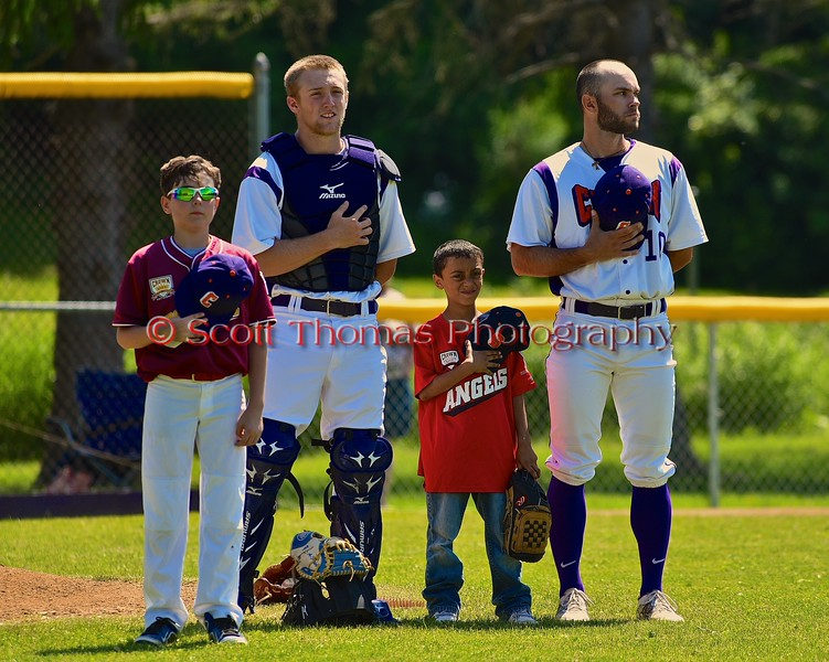 Cortland Crush players George Haaland (34) and Chris Rupprecht (10) with their Crown City Little Leaguers on Greg's Field at Beaudry Park in Cortland, New York on Sunday June 7, 2015.