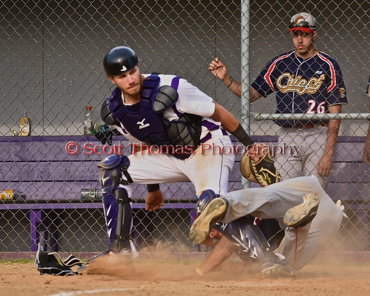 Cortland Crush Chris Mattison (20) tags out Syracuse Junior Chiefs Philip Madonna (55) at home on Greg's Field at Beaudry Park in Cortland, New York on Sunday June 7, 2015. Syracuse won 11-8.