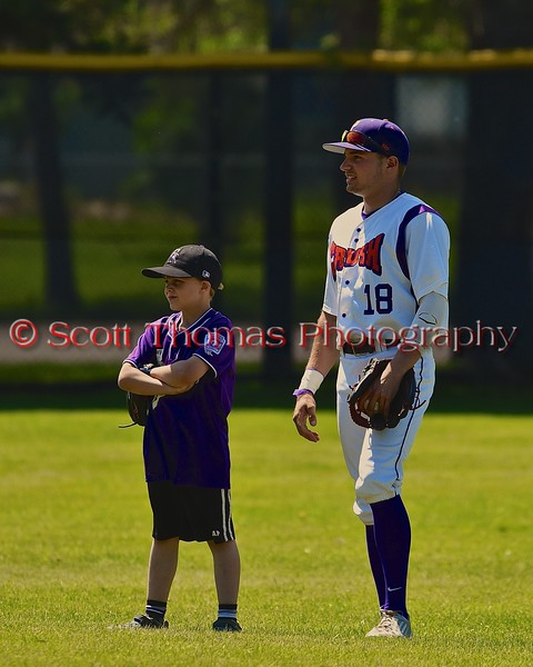 Cortland Crush Grant Hoover (18) with his Crown City Little Leaguer on Greg's Field at Beaudry Park in Cortland, New York on Sunday June 7, 2015.