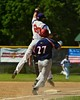 Cortland Crush Chris Mattison (20) catches an errant throw and still gets Syracuse Junior Chiefs Danny Walczak (27) out at first on Greg's Field at Beaudry Park in Cortland, New York on Sunday June 7, 2015. Syracuse won 11-8.