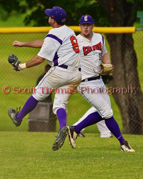 Cortland Crush Wesley Burghardt (8) flings the ball towards first base against the Syracuse Junior Chiefs on Greg's Field at Beaudry Park in Cortland, New York on Sunday June 7, 2015. Syracuse won 11-8.