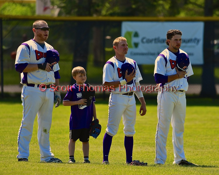 Cortland Crush players and a Crown City Little Leaguer on Greg's Field at Beaudry Park in Cortland, New York on Sunday June 7, 2015.