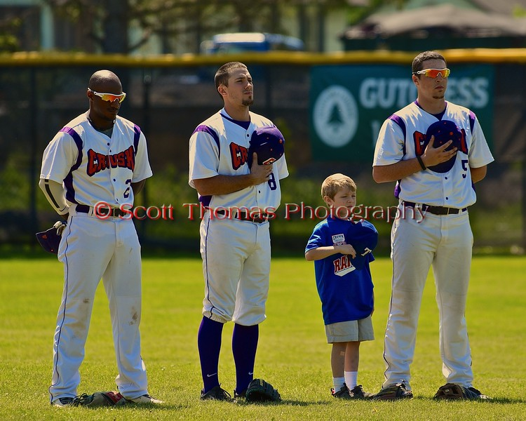 Cortland Crush players Terrell Barringer (23), Wesley Burghardt (8) and Matthew Alberino (5) with a Crown City Little Leaguer on Greg's Field at Beaudry Park in Cortland, New York on Sunday June 7, 2015.