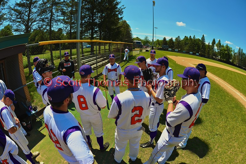 Cortland Crush Manager Bill McConnell holding a pre-game meeting before playing the Syracuse Junior Chiefs on Greg's Field at Beaudry Park in Cortland, New York on Sunday June 7, 2015.