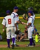Cortland Crush Manager Bill McConnell takes the ball from Cody Barnes (42) as the Crush change pitchers against the Syracuse Junior Chiefs on Greg's Field at Beaudry Park in Cortland, New York on Sunday June 7, 2015. Syracuse won 11-8.