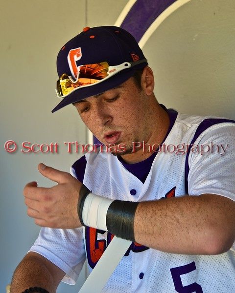 Cortland Crush Matthew Alberino (5) wrapping his wrist in the dugout before playing the Syracuse Junior Chiefs on Greg's Field at Beaudry Park in Cortland, New York on Sunday June 7, 2015.