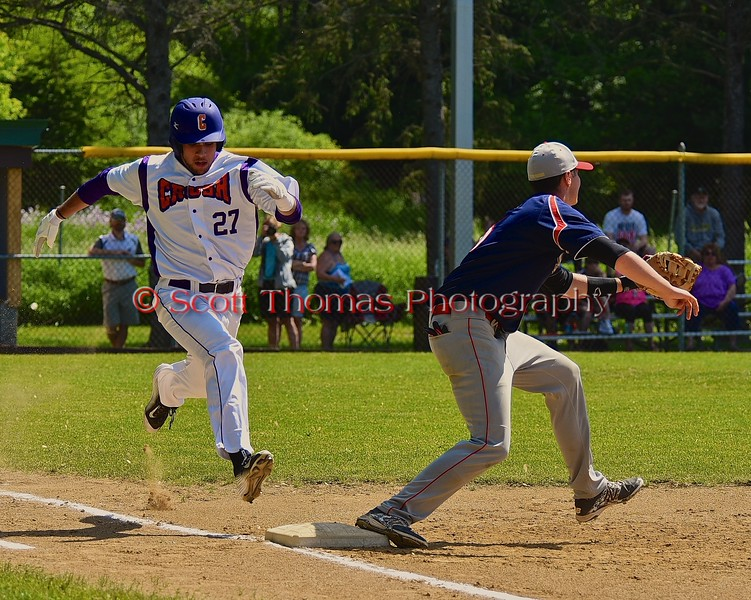 Cortland Crush Luke Gilbert (27) running down the first base line against the Syracuse Junior Chiefs on Greg's Field at Beaudry Park in Cortland, New York on Sunday June 7, 2015. Syracuse won 11-8.