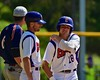 Cortland Crush Grant Hoover (18) talks with the First Base Coach during a timeout against the Syracuse Junior Chiefs on Greg's Field at Beaudry Park in Cortland, New York on Sunday June 7, 2015. Syracuse won 11-8.