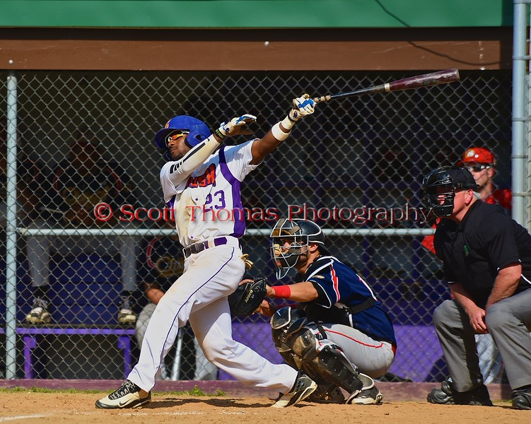 Cortland Crush Terrell Barringer (23) swings through a hit against the Syracuse Junior Chiefs on Greg's Field at Beaudry Park in Cortland, New York on Sunday June 7, 2015. Syracuse won 11-8.