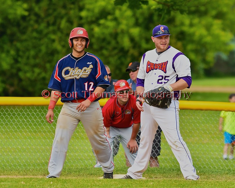 Cortland Crush Zephan Kash (25) and Syracuse Junior Chiefs Christian Vargas (12) at first base on Greg's Field at Beaudry Park in Cortland, New York on Sunday June 7, 2015. Syracuse won 11-8.