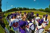 Cortland Crush huddle up before playing the Syracuse Junior Chiefs on Greg's Field at Beaudry Park in Cortland, New York on Sunday June 7, 2015.