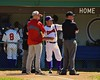 Cortland Crush Manager Bill McConnell talking with the Syracuse Junior Chiefs coach and umpire on Greg's Field at Beaudry Park in Cortland, New York on Sunday June 7, 2015.