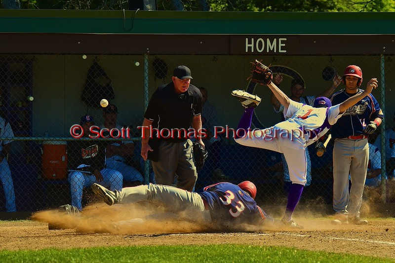 Cortland Crush Crae Watkins (1) gets the ball knocked from him when Syracuse Junior Chiefs Brian Colbert (33) slides into home to score a run on Greg's Field at Beaudry Park in Cortland, New York on Sunday June 7, 2015. Syracuse won 11-8.