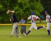 Cortland Crush Grant Hoover (18) is out at first against the Syracuse Junior Chiefs on Greg's Field at Beaudry Park in Cortland, New York on Sunday June 7, 2015. Syracuse won 11-8.