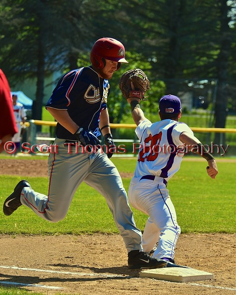 Syracuse Junior Chiefs player beats out the throw to first against the Cortland Crush on Greg's Field at Beaudry Park in Cortland, New York on Sunday June 7, 2015. Syracuse won 11-8.