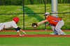 Cortland Crush Neil McCormack (12) about to tag the Syracuse Salt Cats base runner in Syracuse, New York on Wednesday June 10, 2015.  Syracuse won 5-2.