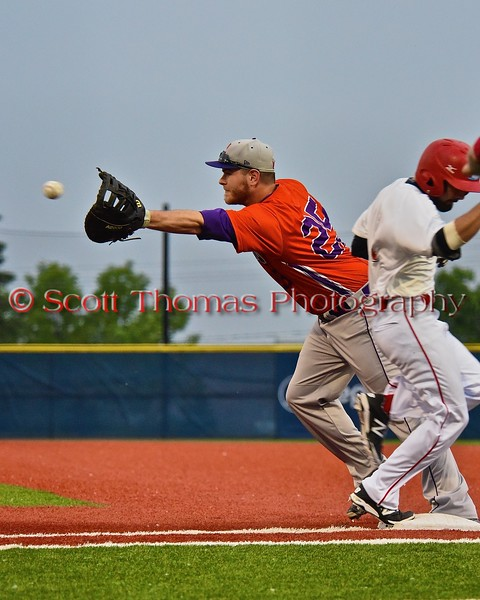 Cortland Crush Zephan Kash (25) about to catch the ball as Syracuse Salt Cats Timothy Hunter (1) gets to first in Syracuse, New York on Wednesday June 10, 2015.  Syracuse won 5-2.