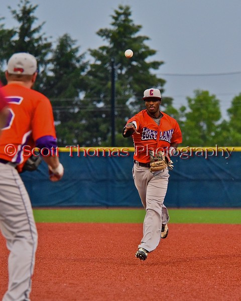 Cortland Crush Terrell Barringer (23) throwing a Syracuse Salt Cats player out at first in Syracuse, New York on Wednesday June 10, 2015.  Syracuse won 5-2.