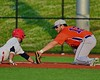 Cortland Crush Neil McCormack (12) take out the Syracuse Salt Cats base runner in Syracuse, New York on Wednesday June 10, 2015.  Syracuse won 5-2.