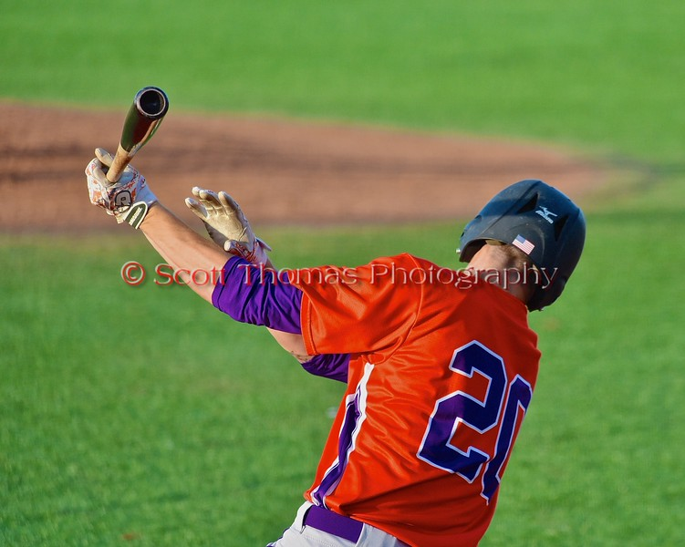 Cortland Crush Chris Mattison (20) follows through on a hit against the Syracuse Junior Chiefs in Syracuse, New York on Friday June 19, 2015. Cortland won 7-5.