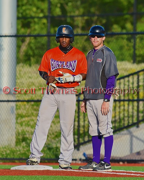 Cortland Crush Terrell Barringer (23) and Assistant Coach Myron Jellison (4) talk strategy at First Base in a game against the Syracuse Junior Chiefs in Syracuse, New York on Friday June 19, 2015. Cortland won 7-5.