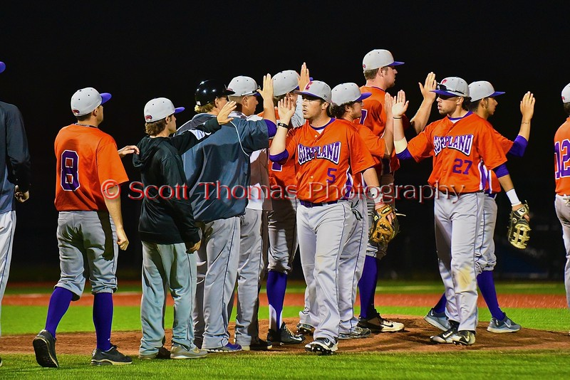 Cortland Crush players celebrate a win over the Syracuse Junior Chiefs in Syracuse, New York on Friday June 19, 2015. Cortland won 7-5.