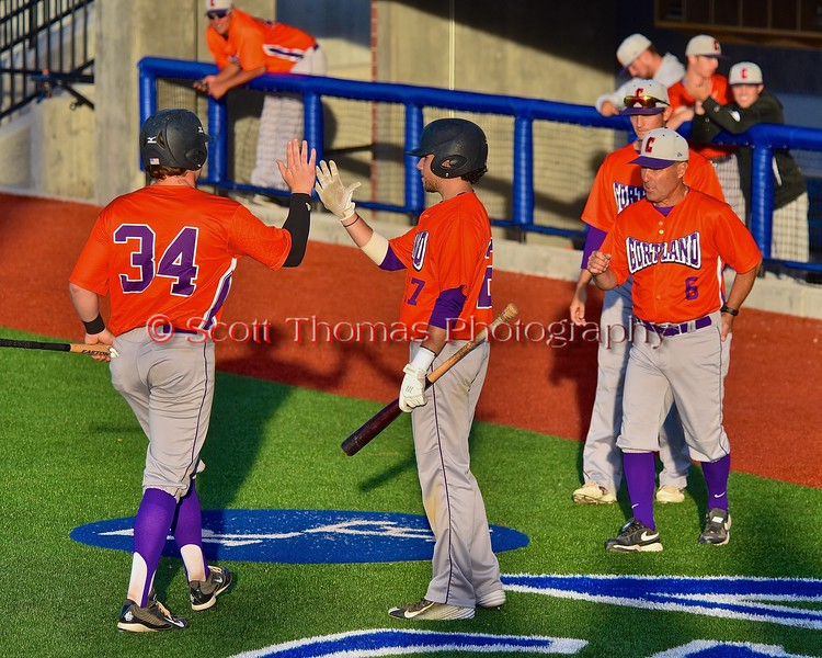 Cortland Crush George Haaland (34) gets congratulated after scoring a run against the Syracuse Junior Chiefs in Syracuse, New York on Friday June 19, 2015. Cortland won 7-5.