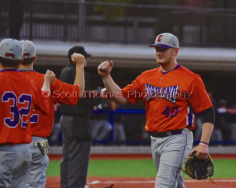 Cortland Crush Cody Barnes (42) gets congratulated after getting out the side in a game against the Syracuse Junior Chiefs in Syracuse, New York on Friday June 19, 2015. Cortland won 7-5.