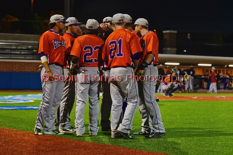 Cortland Crush defenders huddle up before the taking the field at the bottom of the ninth inning against the Syracuse Junior Chiefs in Syracuse, New York on Friday June 19, 2015. Cortland won 7-5.
