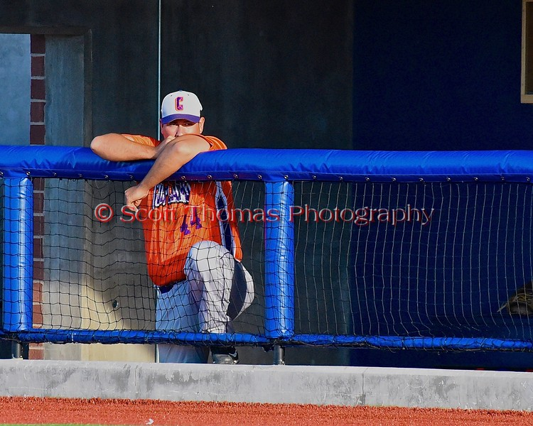Cortland Crush Coach Daniel Payne (44) watches from the Dugout as the Crush play the Syracuse Junior Chiefs in Syracuse, New York on Friday June 19, 2015. Cortland won 7-5.