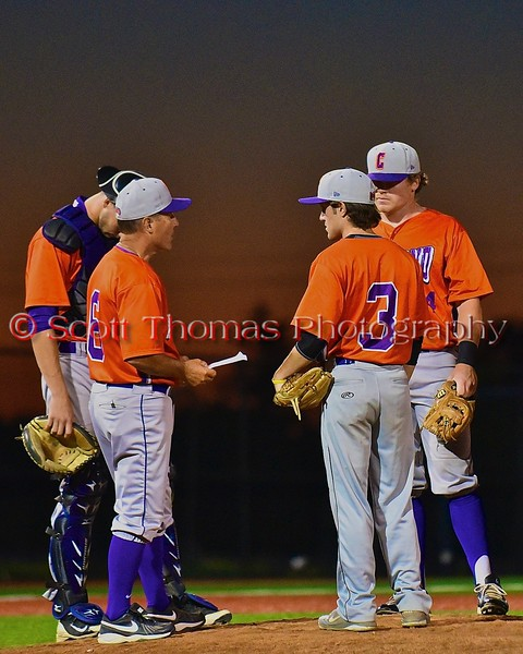Cortland Crush Manager Bill McConnell talks with relief pitcher Matt Yonta (3) in a game against the Syracuse Junior Chiefs in Syracuse, New York on Friday June 19, 2015. Cortland won 7-5.