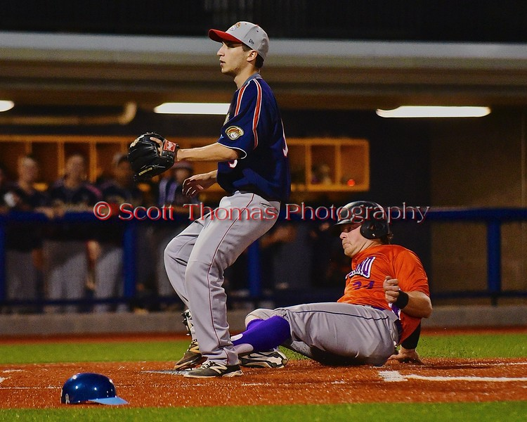Cortland Crush George Haaland (34) slides into Home to score a run against the Syracuse Junior Chiefs in Syracuse, New York on Friday June 19, 2015. Cortland won 7-5.