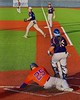 Cortland Crush Zephan Kash (25) slides into Home to score a run against the Syracuse Junior Chiefs in Syracuse, New York on Friday June 19, 2015. Cortland won 7-5.
