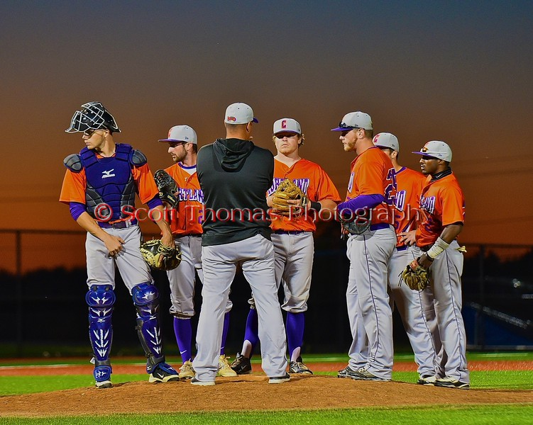 Cortland Crush coaches and players for a conference on the mound against the Syracuse Junior Chiefs in Syracuse, New York on Friday June 19, 2015. Cortland won 7-5.