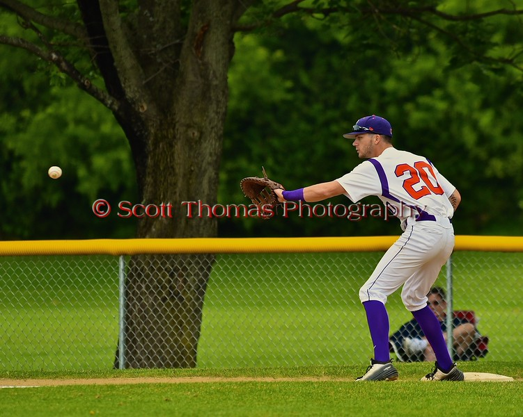 Cortland Crush Chris Mattison (20) about to catch the ball for a forced out against the Syracuse Junior Chiefs on Greg's Field at Beaudry Park in Cortland, New York on Saturday June 20, 2015. Cortland won 4-1.