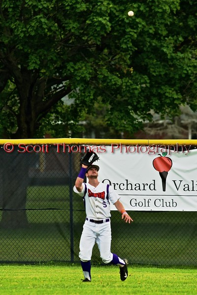 Cortland Crush Julian Gallup (9) closing in on the ball for an out against the Syracuse Junior Chiefs on Greg's Field at Beaudry Park in Cortland, New York on Saturday June 20, 2015. Cortland won 4-1.