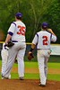 Cortland Crush Hank Pellicciotti (2) comes in to congratulate Tyler Saundry (35) on getting the last out against the Syracuse Junior Chiefs on Greg's Field at Beaudry Park in Cortland, New York on Saturday June 20, 2015. Cortland won 4-1.
